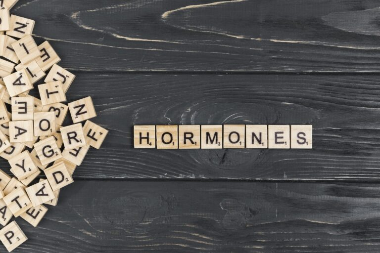The word HORMONES spelt out using Scrabble tiles.