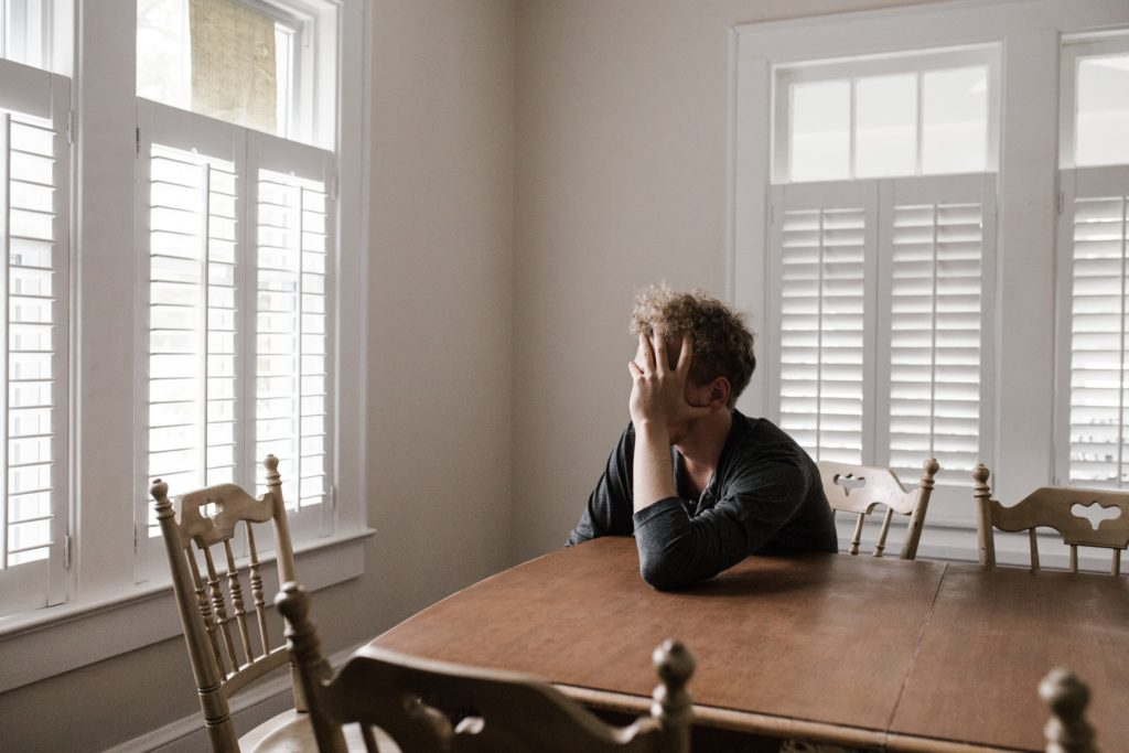 Man with anxiety stressed out inside of his home