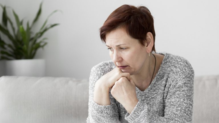 Woman with anxiety sitting on couch